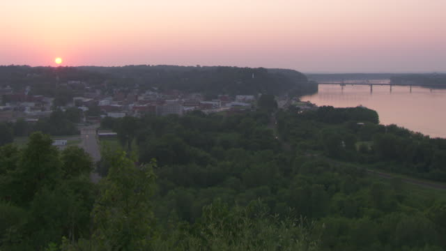 ws shot of hannibal  mississippi river at sunset / hannibal, missouri, united states - mark twain stock videos & royalty-free footage