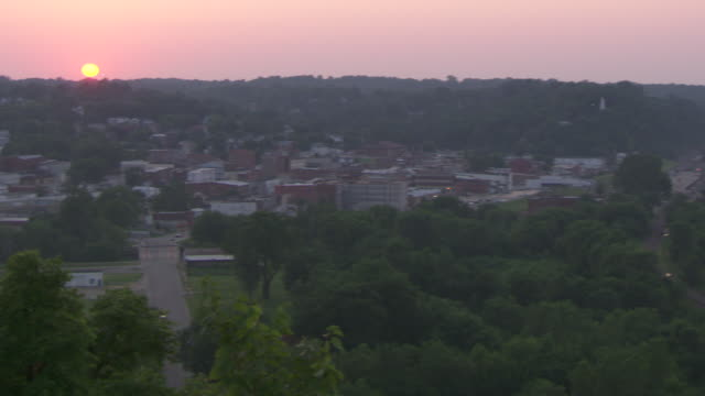 ws pan shot of hannibal mississippi river at sunset / hannibal, missouri, united states - mark twain stock videos & royalty-free footage