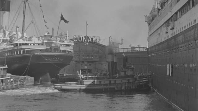 ms shot of  harbor tugs pushing ocean liner  - tugboat stock videos and b-roll footage