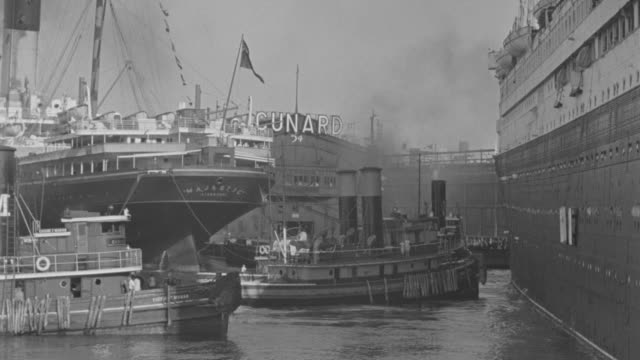 ms pan shot of  harbor tugs pushing ocean liner  - tugboat stock videos and b-roll footage