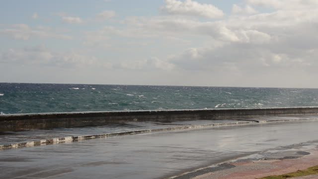 ms shot of havana cuba habana malacon waves crashing over wall on street / havana, cuba - surrounding wall stock videos & royalty-free footage