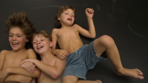 stockvideo's en b-roll-footage met ms slo mo shot of head and shoulders of three caucasian male kids on trampoline, lying on back being bounced / stanford, connecticut, united states - alleen jongens