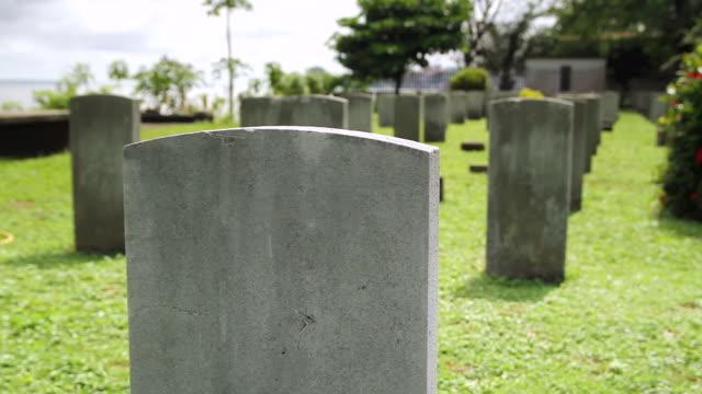 cu shot of headstones in cemetery for fallen service men / freetown, sierra leone - 墓石点の映像素材/bロール