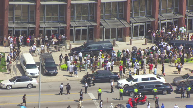 MS AERIAL Shot of hearse and crowd of people in front of Friendly Temple Missionary Baptist Church / St Louis, Missouri, United States