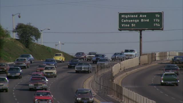 ms td shot of heavy traffic on five lane freeway through cahuenga pass - warner bros stock videos and b-roll footage