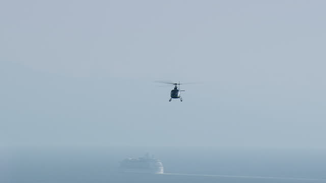 MS AERIAL TS Shot of helicopter flying over sea and cruise ship / Provence Alpes Cote d'Azur, France