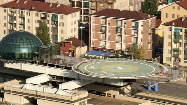 cu aerial zi zo shot of helipad at fiat factory and old factory (lingotto) in city / piedmont, france - piedmont italy stock videos & royalty-free footage
