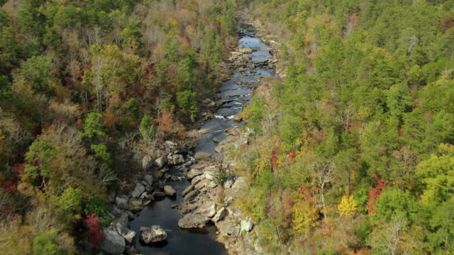 MS AERIAL Shot of high tracking of river to waterfalls at Little River Canyon National Preserve / Fort Payne, Alabama, United States