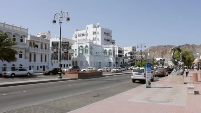 ms shot of highway and buildings at muscat in oman / muscat, oman - 中東点の映像素材/bロール