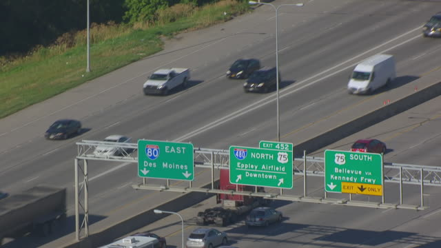 CU AERIAL TU Shot of Highway traffic to painted grain elevators / Omaha, Nebraska, United States