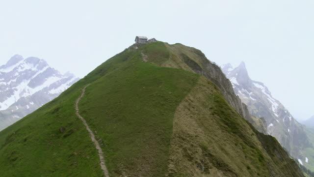 WS AERIAL Shot of hiking trail with mountain guest house / Schafler, Appenzell Innerrhoden, Switzerland