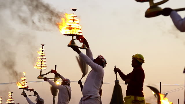 ms shot of hindu priests performing religious ritual aarti on bank of ganges river during kumbh mela / allahabad, uttar pradesh, india - religious celebration stock videos & royalty-free footage