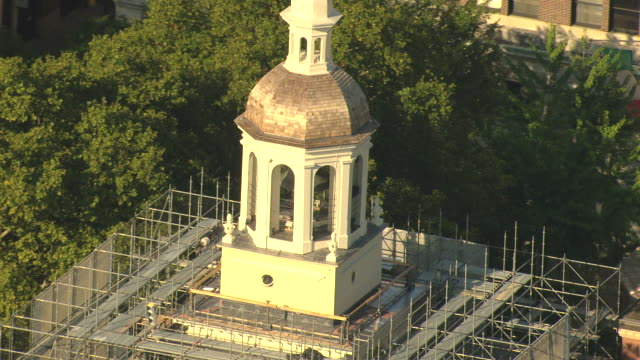 cu aerial zo shot of historic bell tower on top independence hall with scaffolding / philadelphia, pennsylvania, united states - independence hall stock videos and b-roll footage