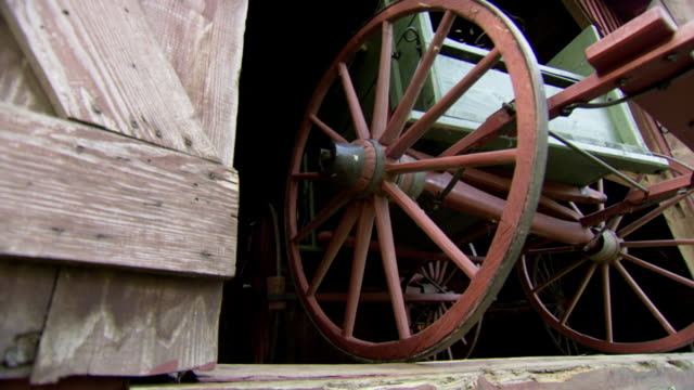MS LA Shot of Historic wagon used to transport runaway slaves being pulled from barn at Mendenhall Plantation / Jamestown, North Carolina, United States
