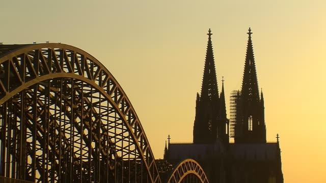 MS Shot of Hohenzollern Bridge, Rhine and Dom at sunset / Cologne, North Rhine Westphalia, Germany