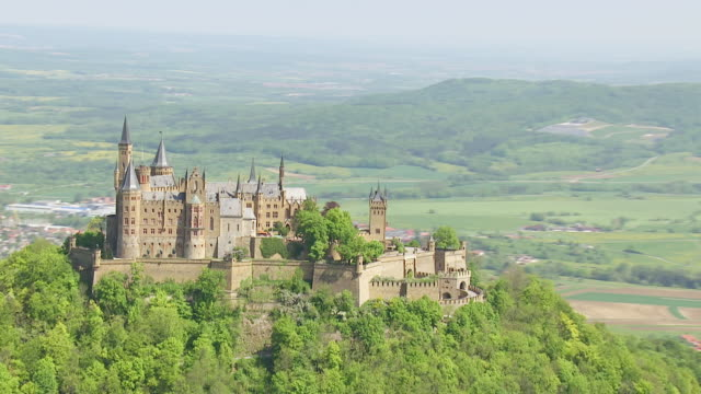 ws aerial ds zo shot of hohenzollern castle on top of mount hohenzollern / bisingen, baden wurttemberg, germany - baden wurttemberg stock videos and b-roll footage