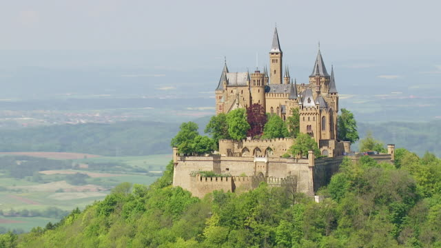 ws aerial zo shot of hohenzollern castle on top of mount hohenzollern / bisingen, baden wurttemberg, germany - castle stock videos & royalty-free footage