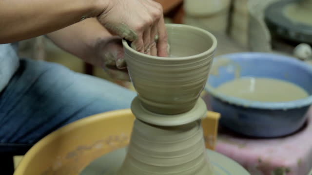 shot of holding clay and making pottery shape with hands and pottery wheel - pottery stock videos & royalty-free footage