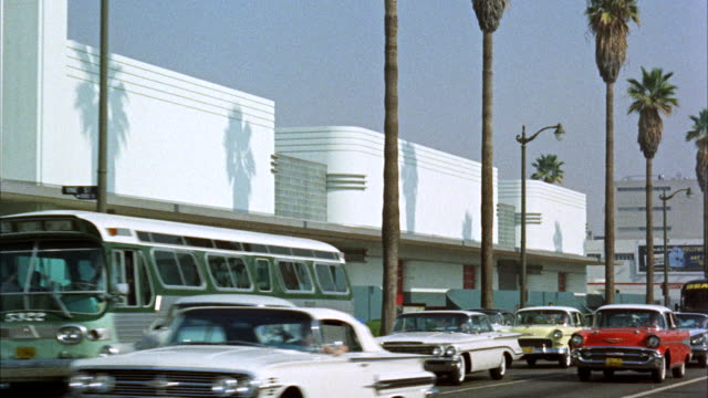 ms pan shot of hollywood, sunset boulevard, nbc studios, and hollywood boulevard with christmas decorations / hollywood, california, united states - 1960 stock-videos und b-roll-filmmaterial