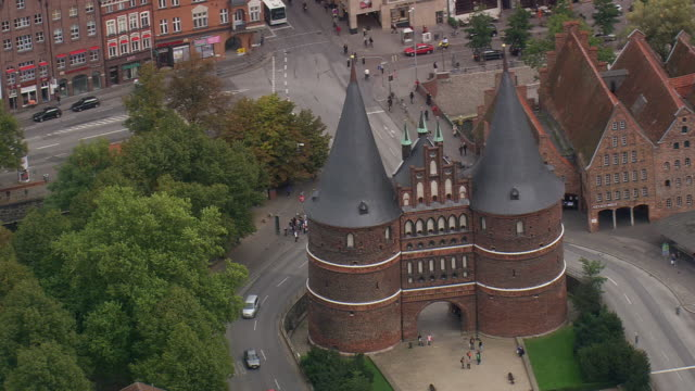 ms aerial shot of holsten gate at lubeck / germany - lübeck stock-videos und b-roll-filmmaterial