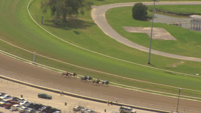 ms aerial ts shot of horses racing on track at fair grounds race course / new orleans, louisiana, united states - horseracing track stock videos and b-roll footage