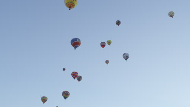 WS Shot of hot air balloons flying through sky / Albuquerque, New Mexico, United States