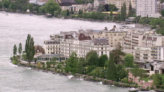 vidéos et rushes de ws aerial shot of hotel in montreux near coast / vaud, switzerland - montreux