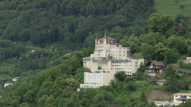 vidéos et rushes de ms aerial shot of hotel on mountain hill in montreux / vaud, switzerland - montreux