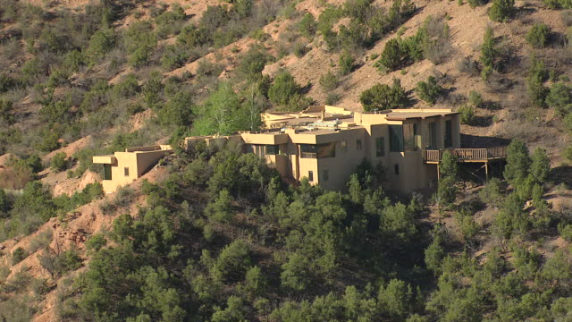 ms aerial shot of house on hill / tesuque, new mexico, united states - pueblo built structure stock videos & royalty-free footage