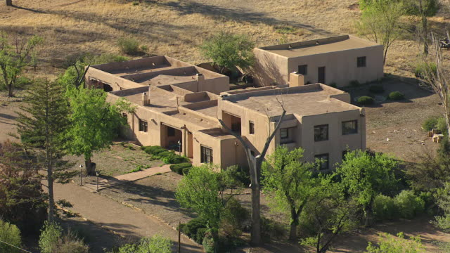 cu aerial shot of house or building / santa fe, new mexico, united states - adobe material stock videos and b-roll footage