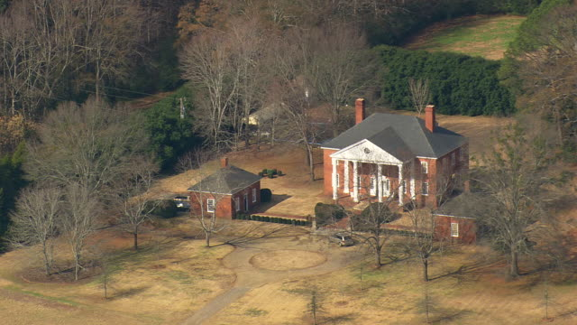 ms aerial ds ts shot of house surrounded by trees / georgia, united states - georgia country stock videos and b-roll footage