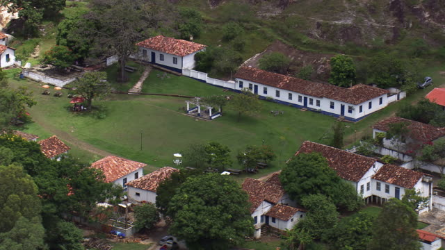 ws aerial shot of house with garden area / minas gerais, brazil - minas stock videos and b-roll footage