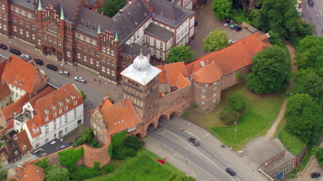 ms aerial ds shot of houses and burgtor at lubeck shots / germany - lübeck stock-videos und b-roll-filmmaterial