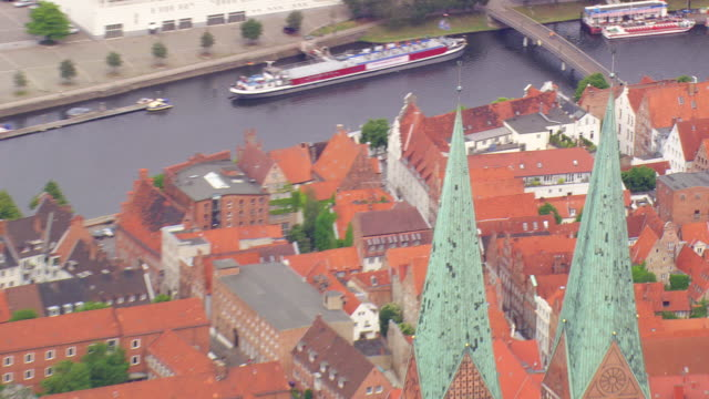 ms aerial zo shot of houses and road way at lubeck / germany - lübeck stock-videos und b-roll-filmmaterial