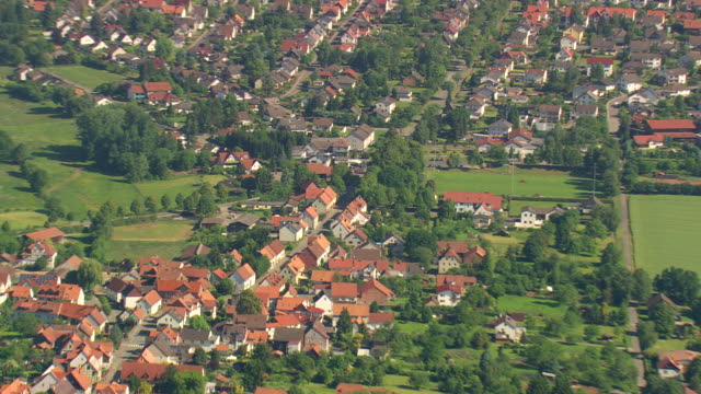 MS AERIAL ZO Shot of houses and road way with farm field/ Germany
