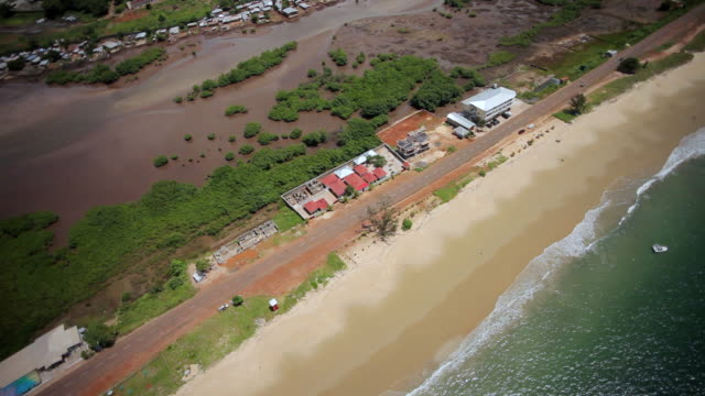 ms aerial shot of houses and sea coast with road / freetown, sierra leone - sierra leone stock videos & royalty-free footage