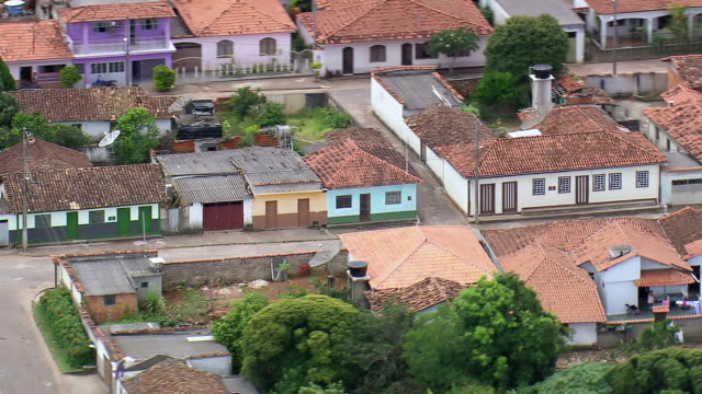 ms aerial shot of houses and street / minas gerais, brazil - minas stock videos and b-roll footage