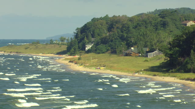 ms aerial shot of houses at lake michigan coastline in muskegon county / michigan, united state - michigan stock videos and b-roll footage