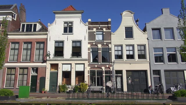 ms shot of houses at turfmarkt / gouda, south holland, netherlands - south holland stock videos and b-roll footage