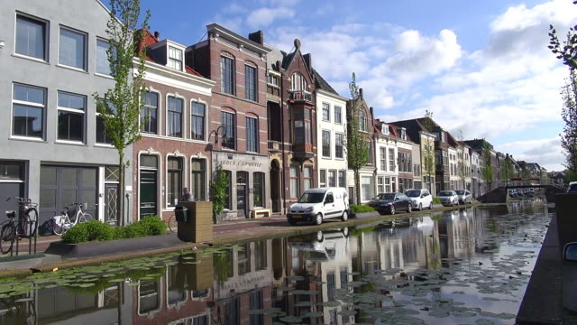 ws shot of houses at turfmarkt / gouda, south holland, netherlands - south holland stock videos and b-roll footage