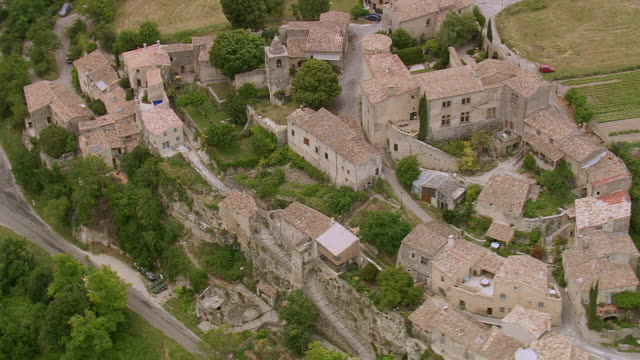MS AERIAL ZO Shot of houses in Autichamp village / Rhone Alpes, France
