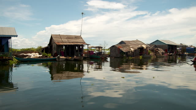 MS POV Shot of houses in Mechrey Floating Village / Siem Reap, Siem Reap Province, Cambodia