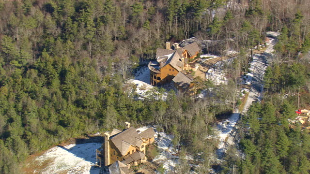 MS AERIAL TS Shot of houses surrounded by trees in Nantahala National Forest / North Carolina, United States