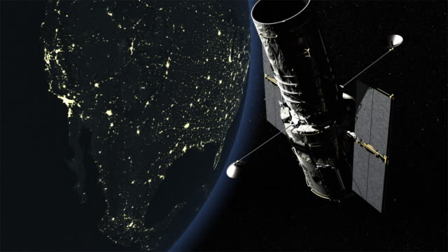 WS PAN Shot of Hubble Space Telescope set against the Earth's night side, lights of cities lit up against dark, Post 2002 version of Telescope