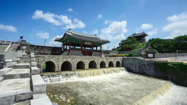 ws t/l shot of hwahongmun water gate in suwonhwasung castle (unesco world heritage site) / suwon, gyeonggi-do, south korea - suwon stock videos and b-roll footage