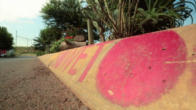 cu shot of 'i love soweto' painted on to sidewalk / johannesburg, gauteng, south africa - 美術工芸品点の映像素材/bロール