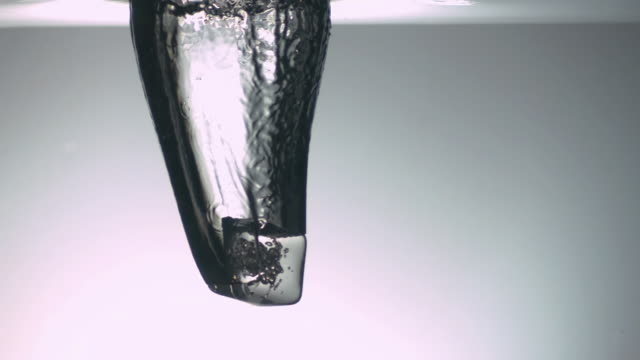 cu slo mo shot of ice cube moving through water - ice cube stock videos & royalty-free footage