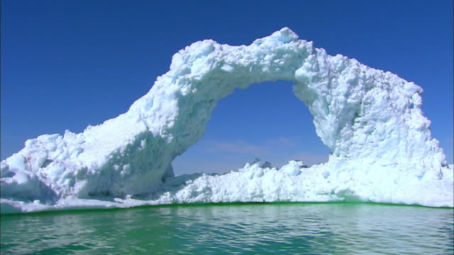 shot of iceberg at antarctic ocean - natural arch stock videos & royalty-free footage