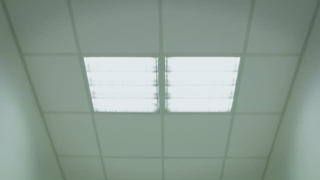 pov shot of illuminated ceiling in hospital - abandoned stock videos & royalty-free footage