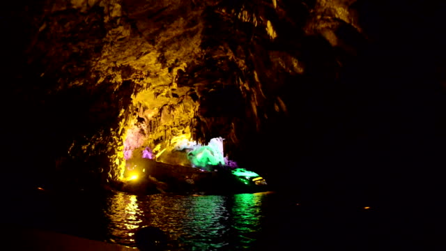 shot of illuminated stalactite cave - stalactite stock videos and b-roll footage